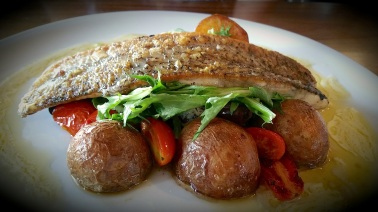 Barramundi with sautéed baby potatoes, olives and cherry tomatoes with beurre blanc sauce
