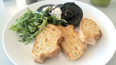 Roasted field mushrooms with goats cheese, rocket and quinoa soy toast