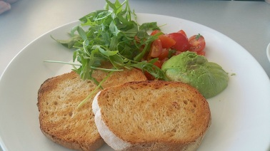 Avocado and cherry tomatoes with toast