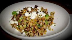Chopped broccoli, puffed grains, walnuts and sheep's feta