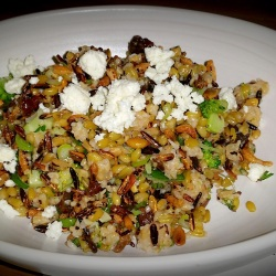 Chopped broccoli, puffed grains, walnuts and sheep's feta